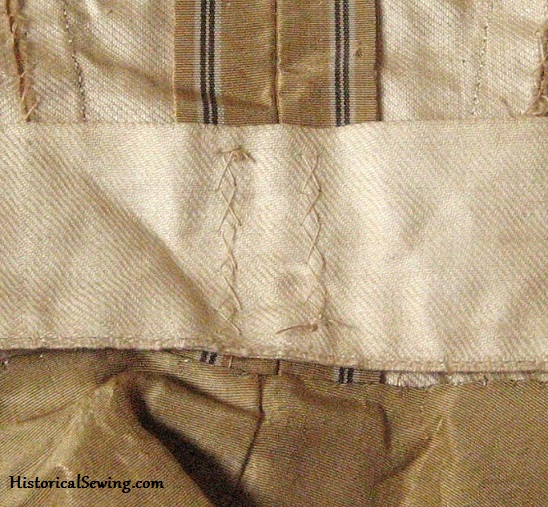 Original 1870s bodice with cross tacks holding the tape in place