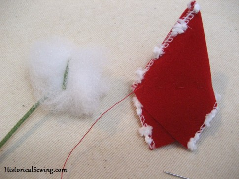 Gathering stitch in bud and creating stuffing puff