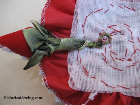 Bud on wire sewn to crinoline