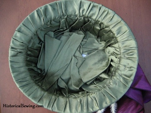 Inside of hat showing the silk mushed down flat