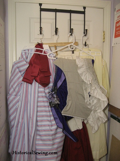 Storing costumes on hooks behind the door