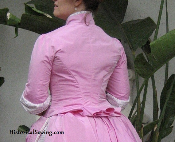 1886 Pink bodice back with tail pleats