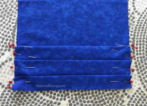 Pleats folded and pinned   HistoricalSewing.com