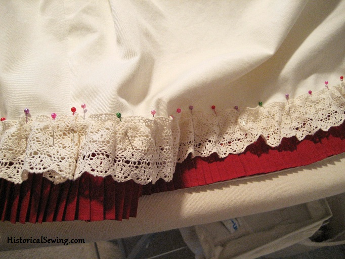 Pinning Lace over Pleats on Underskirt Hem