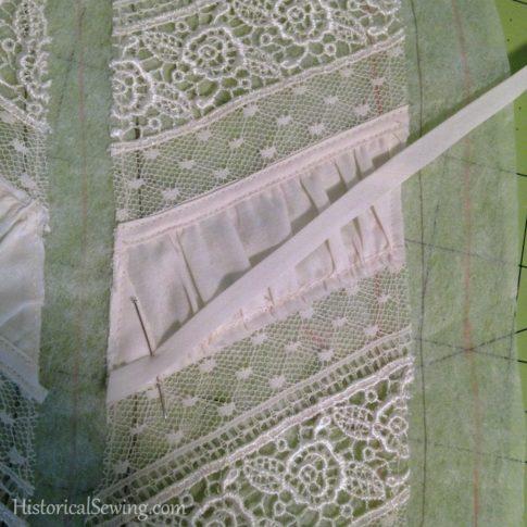 1880 Vanilla Dressing Gown Pinning bias tape over fabric puff