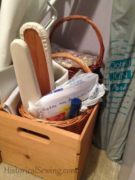 Odd sewing items in wood crates
