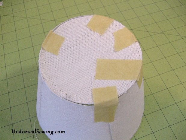 Taping tip to crown before sewing